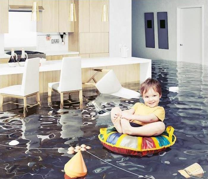 Baby floating in flood waters